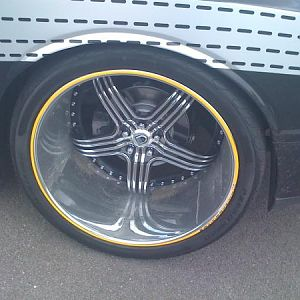 24 inch deep dished rim from a Challenger with a wide body kit