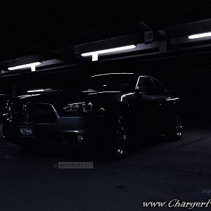 A Night Shot of My Charger In a Garage In Addison